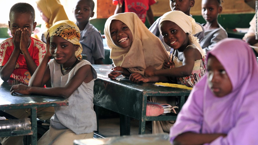 Children pose in a classroom at the Friendship Primary school in Zinder on June 1, 2012.