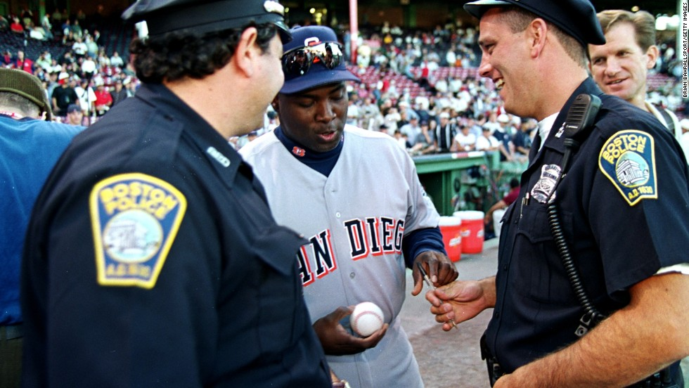 Gwynn signs a baseball for two police officers before the 1999 All-Star Game. Gwynn made the All-Star team in 15 of his 20 seasons.