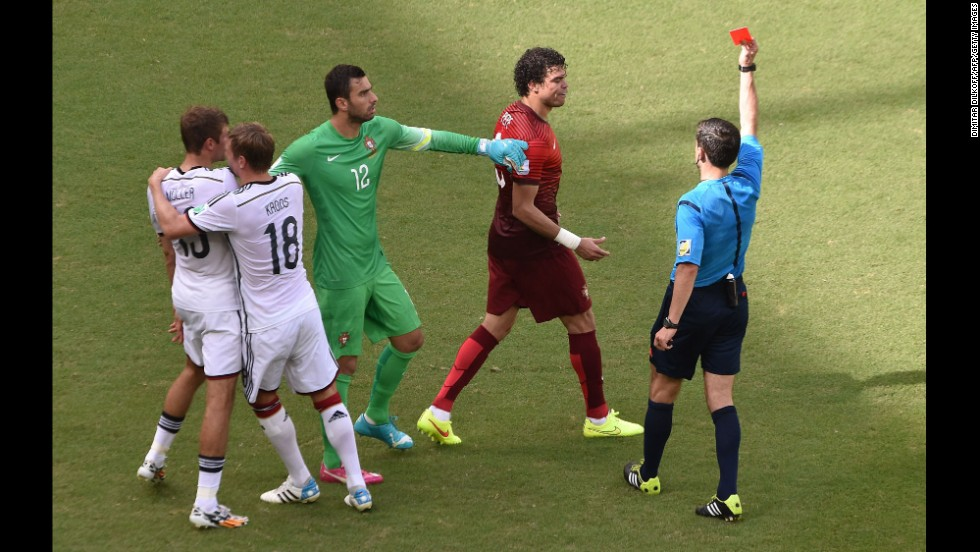 Portuguese defender Pepe, second right, receives a red card after clashing with Mueller in the first half.