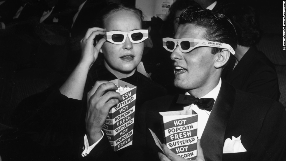 "Actor Keefe Brasselle and his wife, Norma, wear 3-D glasses at the 1952 premiere of ""Bwana Devil"" in Hollywood, California. Discomfort associated with the glasses has been a problem throughout the history of 3-D entertainment, but the technology is finally going glasses-free."