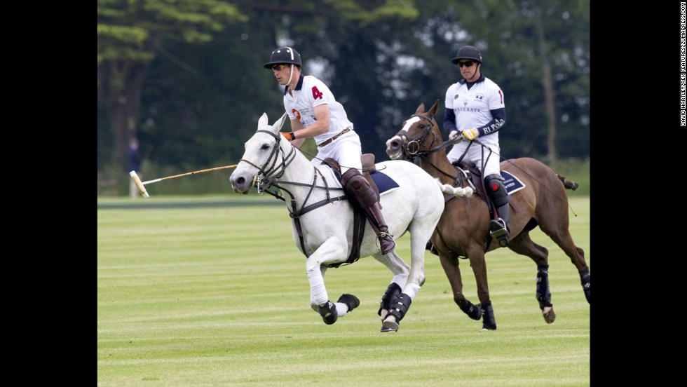Britain's Prince William, left, competes in a charity polo match Sunday, June 15, in Cirencester, England.