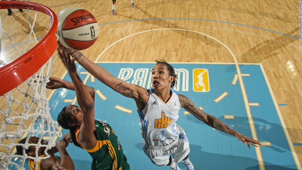 Tamera Young of the Chicago Sky, right, shoots against Camille Little of the Seattle Storm during a WNBA game in Rosemont, Illinois, on Tuesday, June 10.