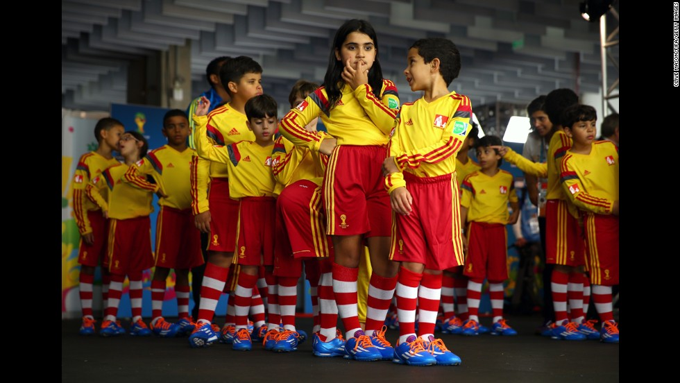 Children prepare to enter the stadium with the national soccer teams from Switzerland and Ecuador prior to a World Cup match Sunday, June 15, in Brasilia, Brazil.