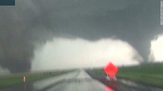 Storm chaser on double tornado forming