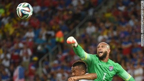 U.S. goalkeeper Tim howard, right, vies with Ghana forward Jordan Ayew.