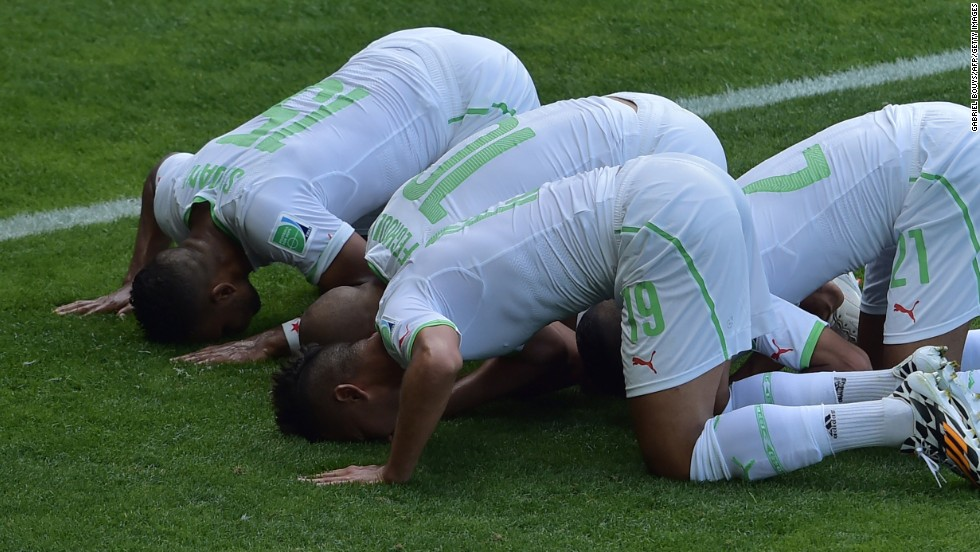 Algerian players celebrate after Sofiane Feghouli, second from left, scored on a penalty kick to give his team a 1-0 lead.