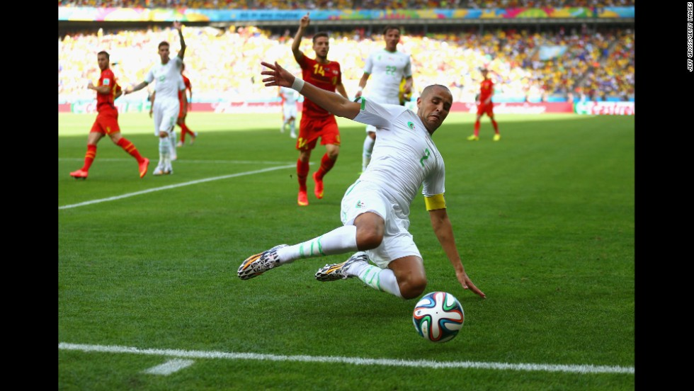 Algeria's Madjid Bougherra reaches for the ball.