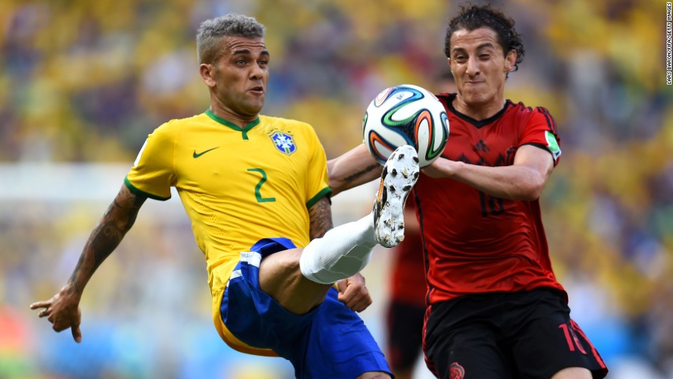 Dani Alves, left, controls the ball next to Andres Guardado of Mexico.