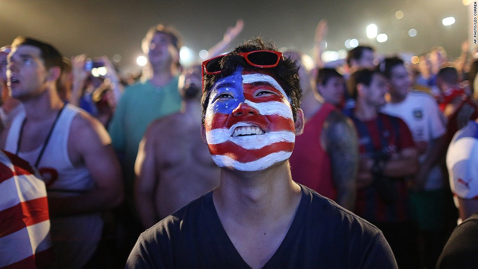 "JUNE 17 - RIO DE JANEIRO, BRAZIL: A U.S. national football team fan watches a live broadcast of the World Cup match between USA and Ghana inside the FIFA Fan Fest area on Copacabana beach on June 16. <a href=""http://cnn.com/2014/06/12/sport/football/world-cup-schedule-of-matches/index.html"">The United States won 2-1 thanks to defender John Brooks' header in the 86th minute. </a>"