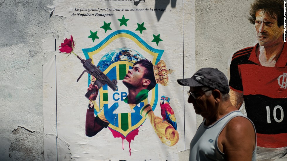 "A poster of Brazilian poster boy Neymar after being hijacked by graffiti artists shows the striker holding a machine gun with a rose sprouting from the barrel.<br /><br />Views of graffiti in Brazil differ widely but it is generally not something that is frowned upon by the authorities as it can be in other countries.<br /><br />""It's easy to paint in cities like Sao Paulo because there is lots of space,"" said Cranio. ""The police don't usually stop people because they think the art is nicer than the blank or white space."""