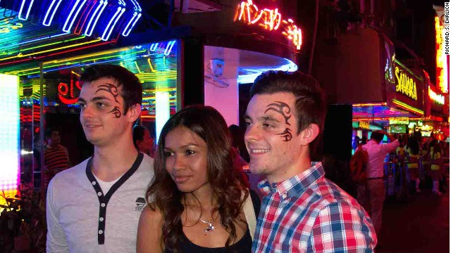 Cameron Johnson and his brother, Brad, accompanied by a Hangover Tour guide, on Soi Cowboy.