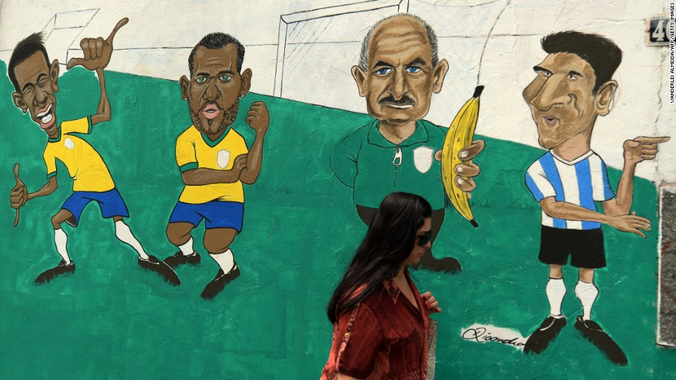 Brazil expects!<br /><br />Brazil's national team footballers (left to right) Neymar, Daniel Alves, coach Luiz Felipe Scolari and Argentina's Lionel Messi, are caricatured in a Rio de Janeiro suburb.<br /><br />The host nation could meet their great regional rival, Argentina, in the World Cup final on July 13th, a fixture that would be one of the biggest and most important ever staged in South America.