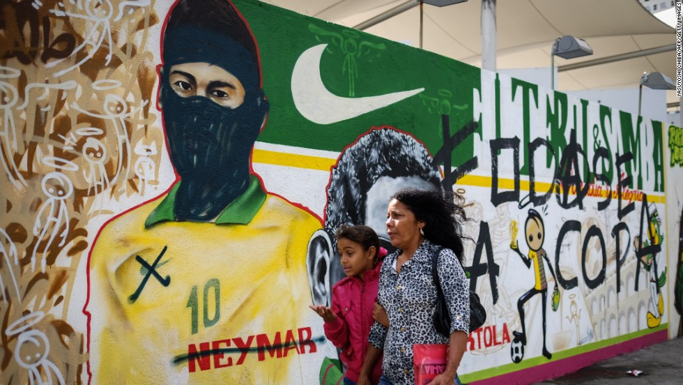 "Another image of Neymar which has been co-opted by artists shows the striker in a balaclava. On his shirt, the symbol of one of the side's main sponsors, Nike, has been crossed out.<br /><br />One of the main issues that angered protestors in the run up to the World Cup was the perceived preferential treatment offered to FIFA and their partners (although Nike is not one of these).<br /><br />A large chunk of the cost of hosting the tournament (including the building of stadiums) was also borne by the Brazilian taxpayer.<br />""I think theses events should be held in places where they don't have so many issues,"" said Cranio. <br /><br />""They are spending a lot of money on the World Cup and are forgetting about the problems that people have already."""