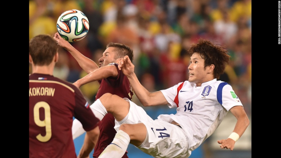 South Korean midfielder Han Kook-Young, right, vies for the ball.