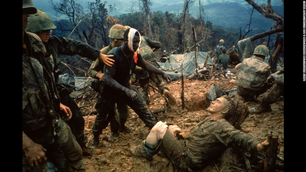 "1960s photojournalists showed the world some of the most dramatic moments of the Vietnam War through their camera lenses. LIFE magazine's Larry Burrows photographed wounded Marine Gunnery Sgt. Jeremiah Purdie, center, reaching toward a stricken soldier after a firefight south of the Demilitarized Zone in Vietnam in 1966. Commonly known as <a href=""http://life.time.com/history/vietnam-war-the-story-behind-larry-burrows-1966-photo-reaching-out/#1"" target=""_blank"">Reaching Out,<em></a> </em>Burrows shows us tenderness and terror all in one frame. According to LIFE, the magazine did not publish the picture until five years later to commemorate Burrows, who was killed with AP photographer Henri Huet and three other photographers in Laos."