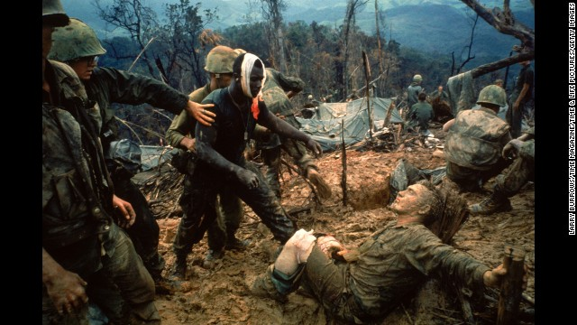 Wounded Marine Gunnery Sgt. Jeremiah Purdie (C) beCaption:VIET NAM - 1966: Wounded Marine Gunnery Sgt. Jeremiah Purdie (C) being led past stricken comrade after fierce firefight for control of Hill 484 south of the DMZ. (Photo by Larry Burrows/Time Magazine/Time amp; Life Pictures/Getty Images)