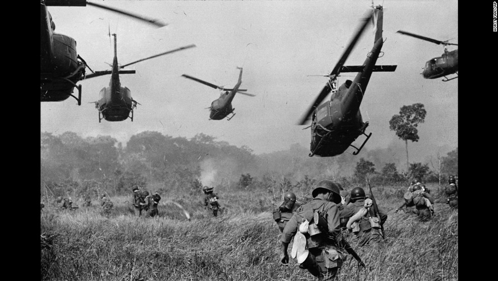 This 1965 photo by Horst Faas shows U.S. helicopters protecting South Vietnamese troops northwest of Saigon. As the Associated Press chief photographer for Southeast Asia from 1962-1974, Faas earned two Pulitzer Prizes.