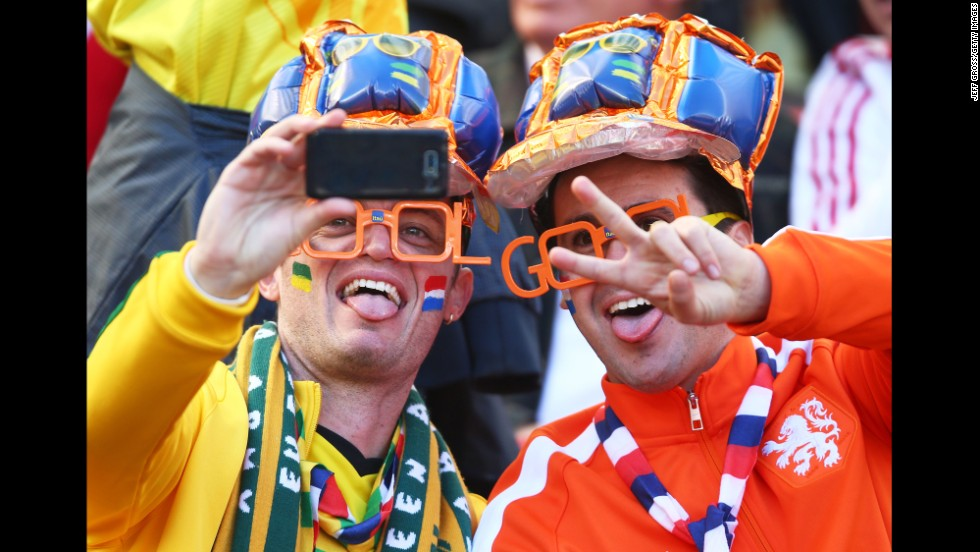 "Fans take a selfie before the match. <a href=""http://www.cnn.com/2014/06/17/football/gallery/world-cup-0617/index.html"">See the best World Cup photos from June 17. </a>"