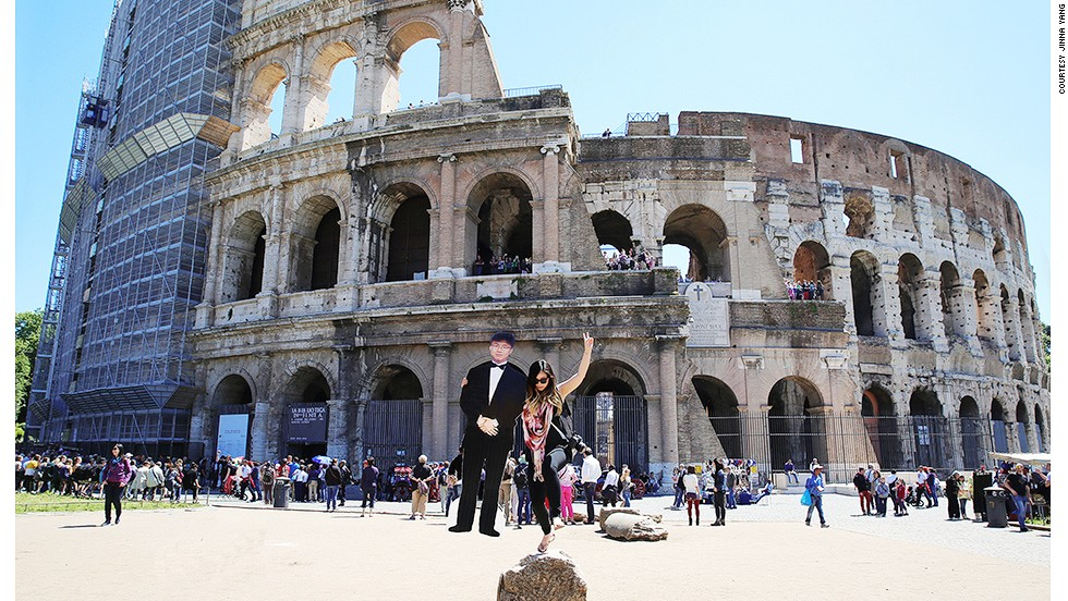 """I have a friend whose father helped me score the cutout so that it folded in and out,"" Yang says, here at Rome's Colosseum. ""It became portable enough to carry around after I folded it up."""