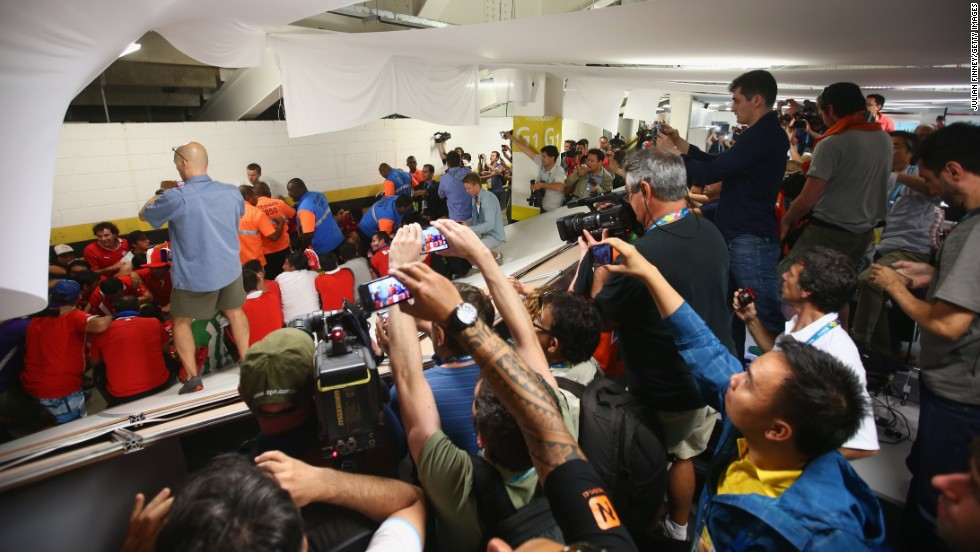 "Security personnel attempt to control Chilean fans who <a href=""http://bleacherreport.com/articles/2101732-chile-fans-break-into-maracana-press-room-before-world-cup-match-vs-spain"" target=""_blank"">invaded the press room</a> at the Maracana Stadium before the match."