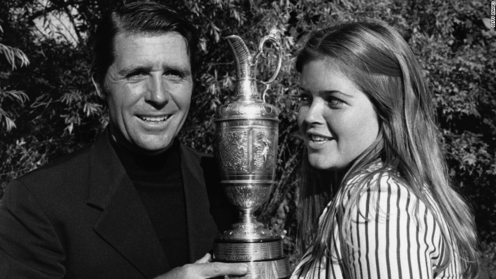 Gary Player holds the 1974 British Open trophy aloft with his then 15-year-old daughter Jennifer after his victory at Royal Lytham.