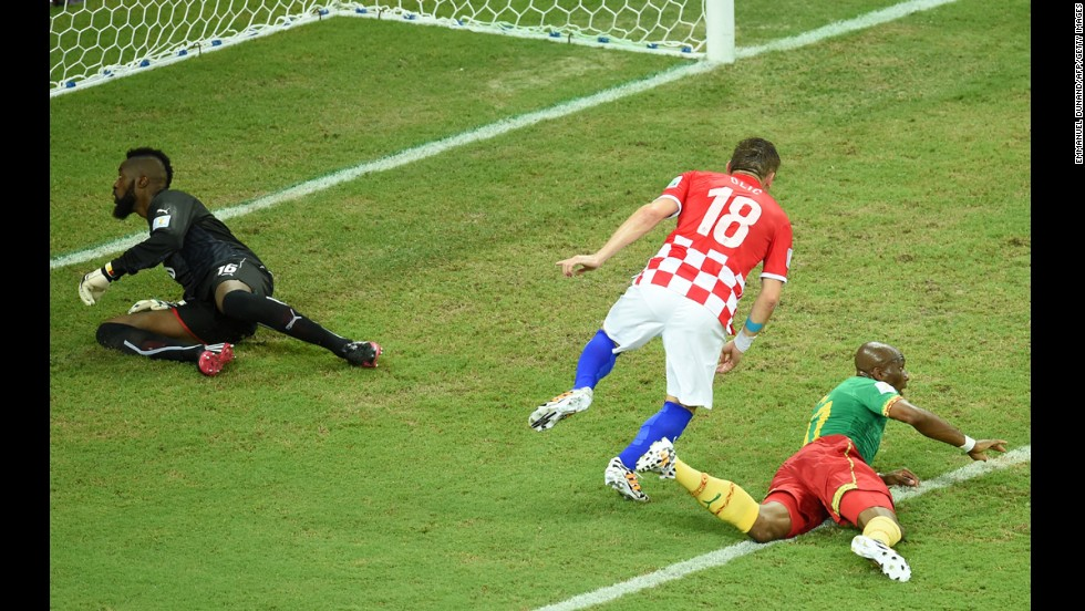Croatian forward Ivica Olic, center, celebrates after scoring against the team's opening goal against Cameroon.