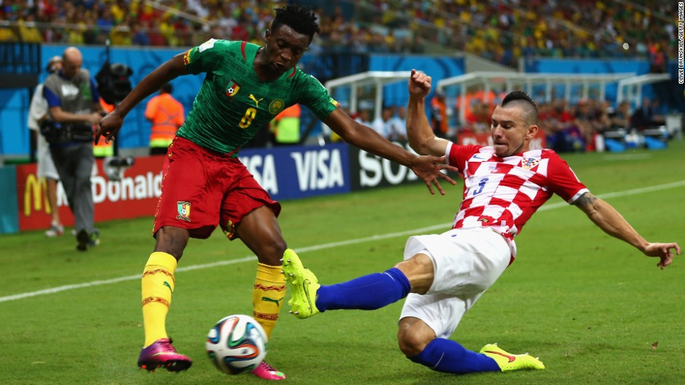 Benjamin Moukandjo of Cameroon is tackled by Danijel Pranjic of Croatia.