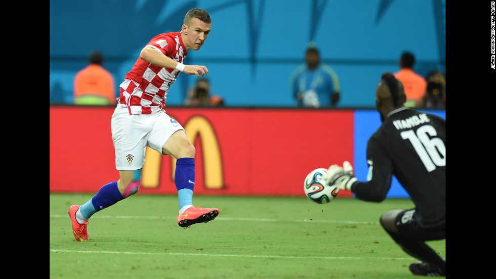 Croatian midfielder Ivan Perisic shoots past Itandje.