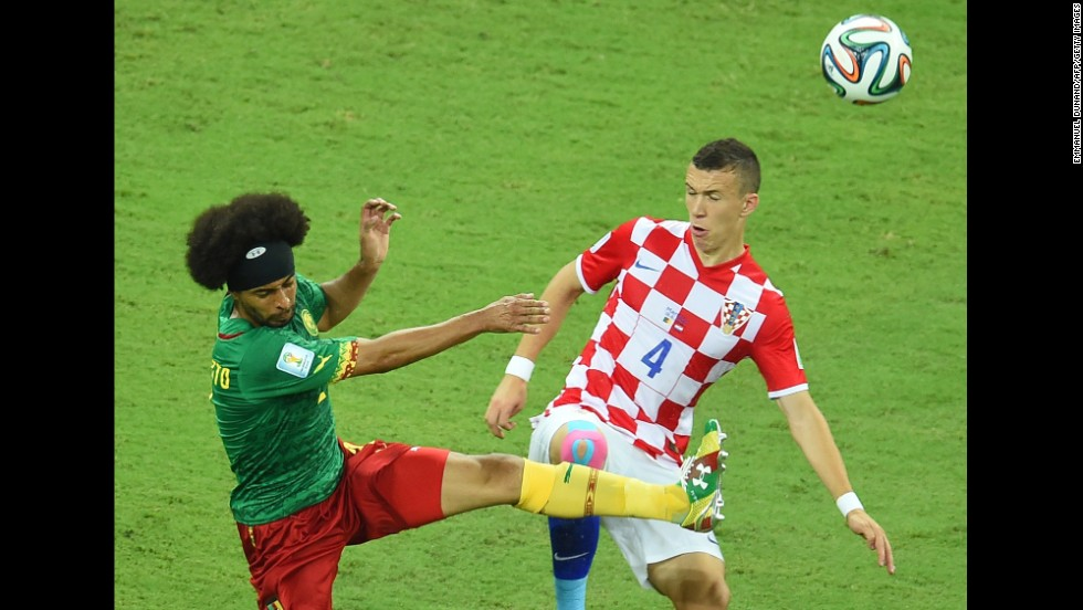 Cameroon's Benoit Assou-Ekotto challenges Croatia's Ivan Perisic.
