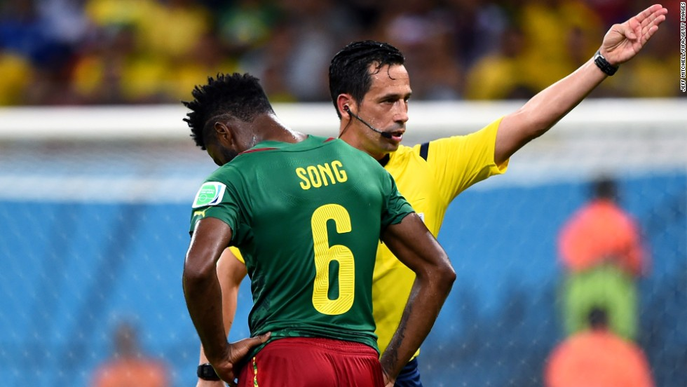 Alexandre Song of Cameroon is sent off by referee Pedro Proenca.