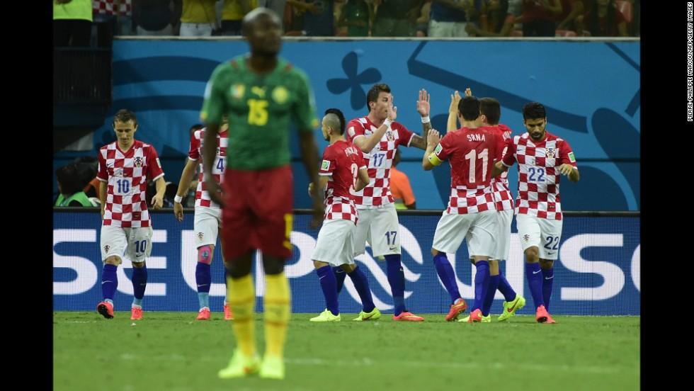 Croatia's team celebrates Mario Mandzukic's second goal.