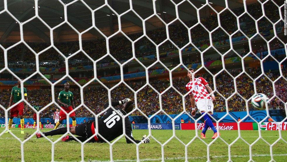 Mario Mandzukic of Croatia scores his second goal past Charles Itandje of Cameroon during a World Cup match Wednesday, June 18, in Manaus, Brazil. Croatia won 4-0, eliminating Cameroon from World Cup contention.