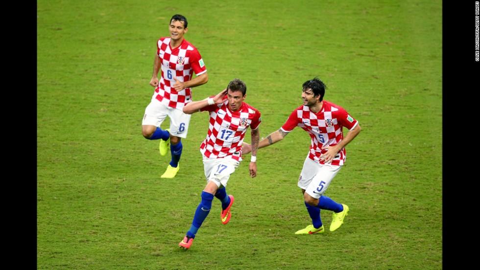 Mandzukic, center, celebrates scoring Croatia's third goal with his teammates Dejan Lovren, left, and Vedran Corluka.