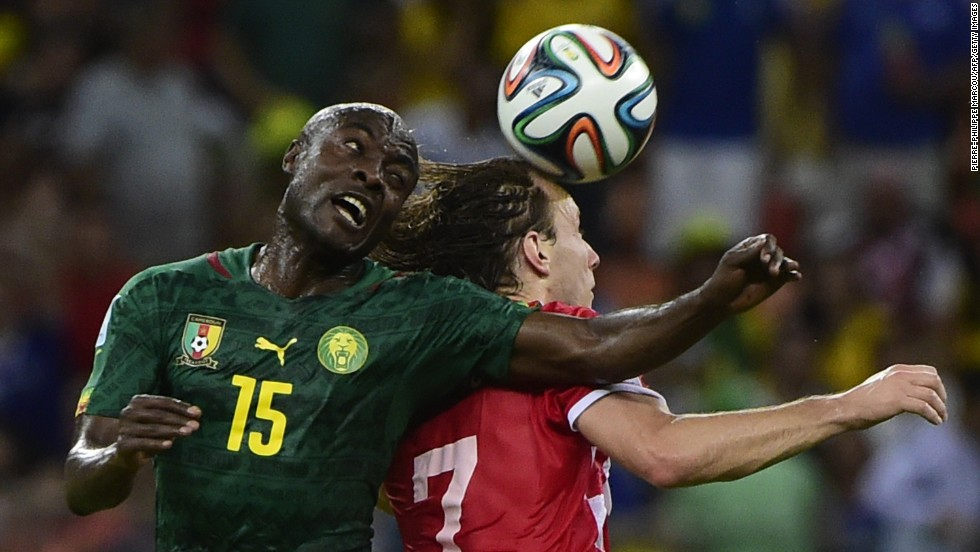 Cameroon's Pierre Webo, left, and Croatia's Ivan Rakitic vie for the ball.