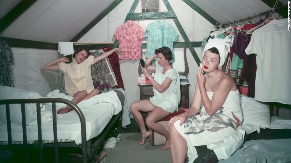 Three young women get ready for work in their three-person tent at  Camp Curry in Yosemite National Park, where they were employed for the summer of 1955.