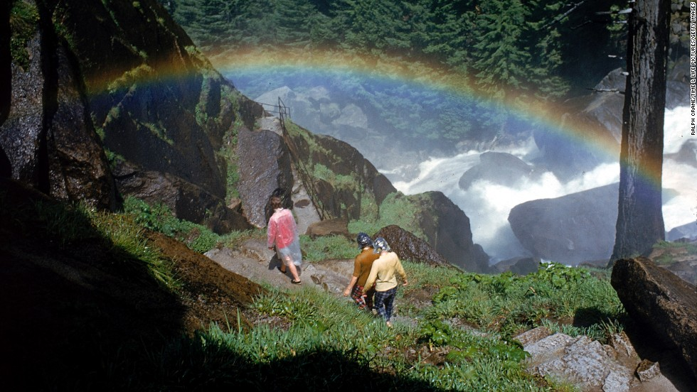 "Hikers walk past a rainbow caused by mist from Vernal Falls, circa 1962. There are <a href=""http://www.nps.gov/yose/planyourvisit/hiking.htm"" target=""_blank"">800 miles of trails</a> at the park."