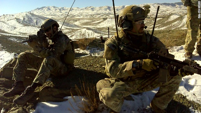 Maj. Charlie Hodges, right, an Air Force special tactics officer, stands watch during a combat mission in Afghanistan.