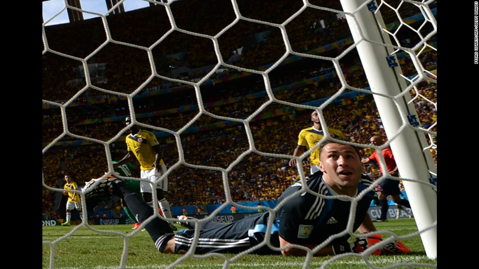 Colombian goalkeeper David Ospina fails to stop a second-half shot by Ivory Coast forward Gervinho during a World Cup match Thursday, June 19, in Brasilia, Brazil. Colombia won the match 2-1.