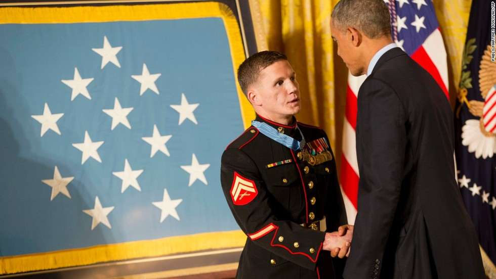 Retired Marine Cpl. Kyle Carpenter shakes hands with President Barack Obama as he receives the Medal of Honor on June 19. While serving in Afghanistan, Carpenter used his body to shield a fellow Marine from a grenade blast on November 21, 2010.
