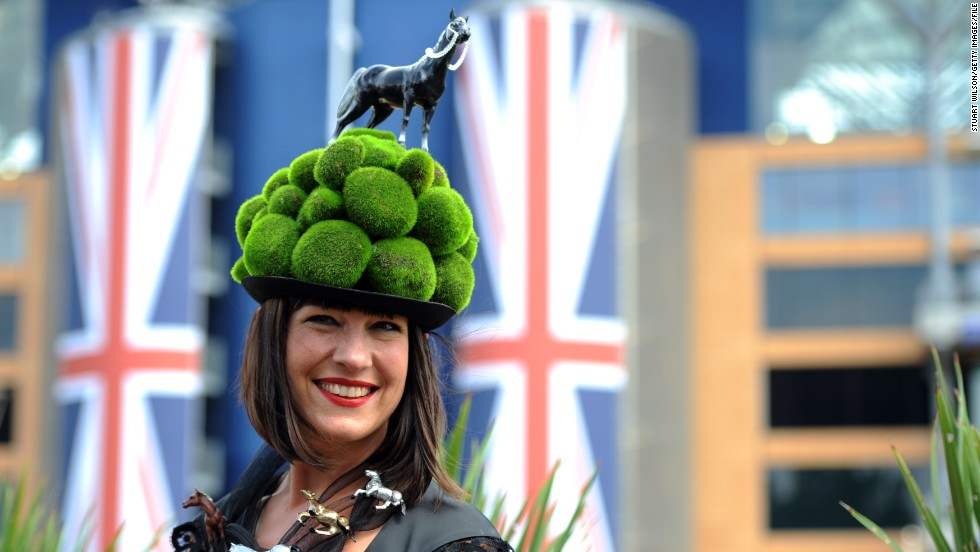 Hats are an essential part of the race-goer's outfit, from dramatic Hepburn-style sweeping brims, to whacky home-made works of art. This pom pom head piece might not be to everyone's taste, but earns full marks for creativity.