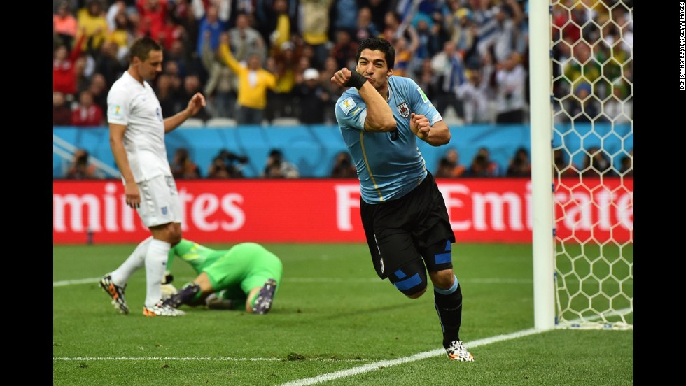 Suarez celebrates after steering a header past English goalkeeper Joe Hart in the first half.