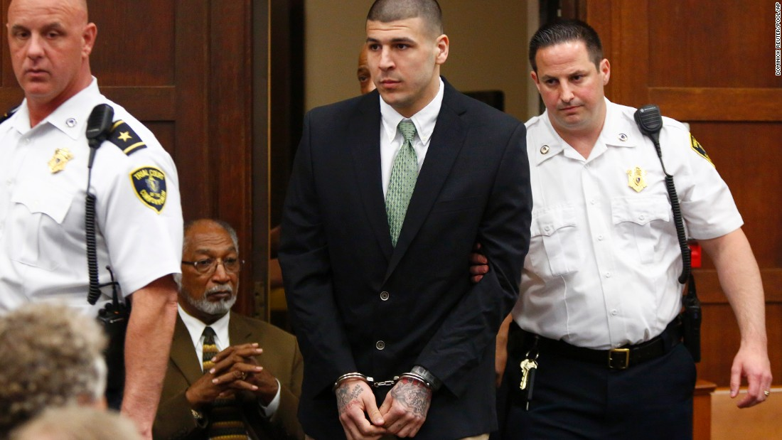Former New England Patriots tight end Aaron Hernandez is led into the courtroom to be arraigned on homicide charges Wednesday, May 28, in Boston. Hernandez pleaded not guilty in the 2012 killings of Daniel de Abreu and Safiro Furtado. He has also been charged in the 2013 death of semipro football player Odin Lloyd.