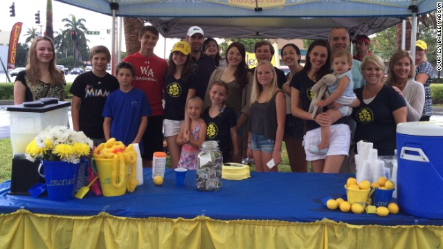 Bailee Madison and friends pose at a lemonade stand at an event in Fort Lauderdale, Florida.