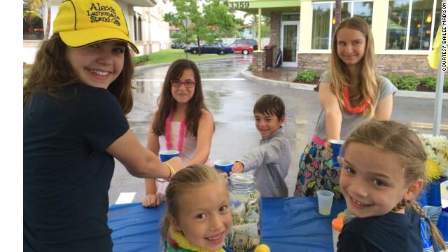 Madison serves up lemonade to customers.