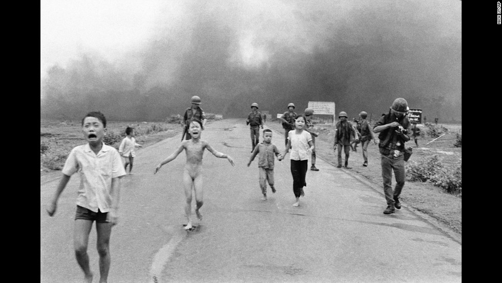 Associated Press photographer Nick Ut photographed terrified children running from the site of a Vietnam napalm attack in 1972. A South Vietnamese plane accidentally dropped napalm on its own troops and civilians. Nine-year-old Kim Phuc, center, ripped off her burning clothes while she ran. The image communicated the horrors of the war and contributed to growing U.S. anti-war sentiment. After taking the photograph, Ut took the children to a Saigon hospital.