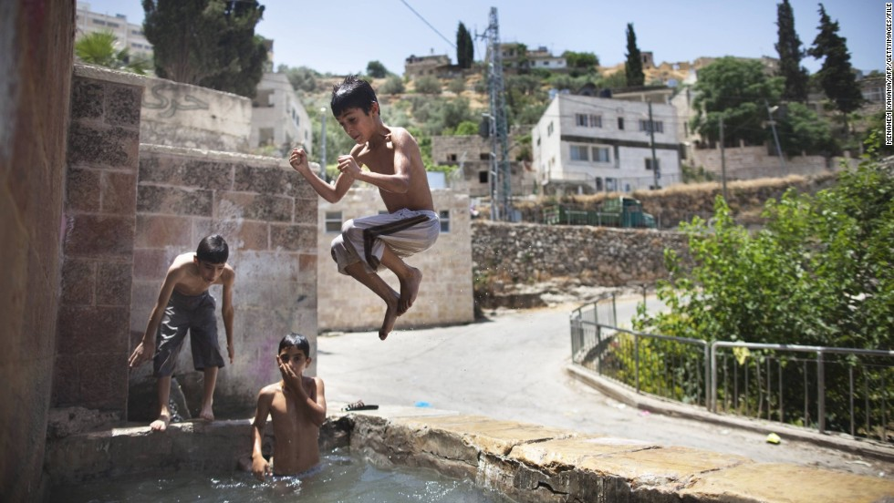 Palestinian children jump in an ancient spring in the West Bank village of Battir, which was the first site UNESCO added to its World Heritage List during its June 2014 meeting in Qatar.