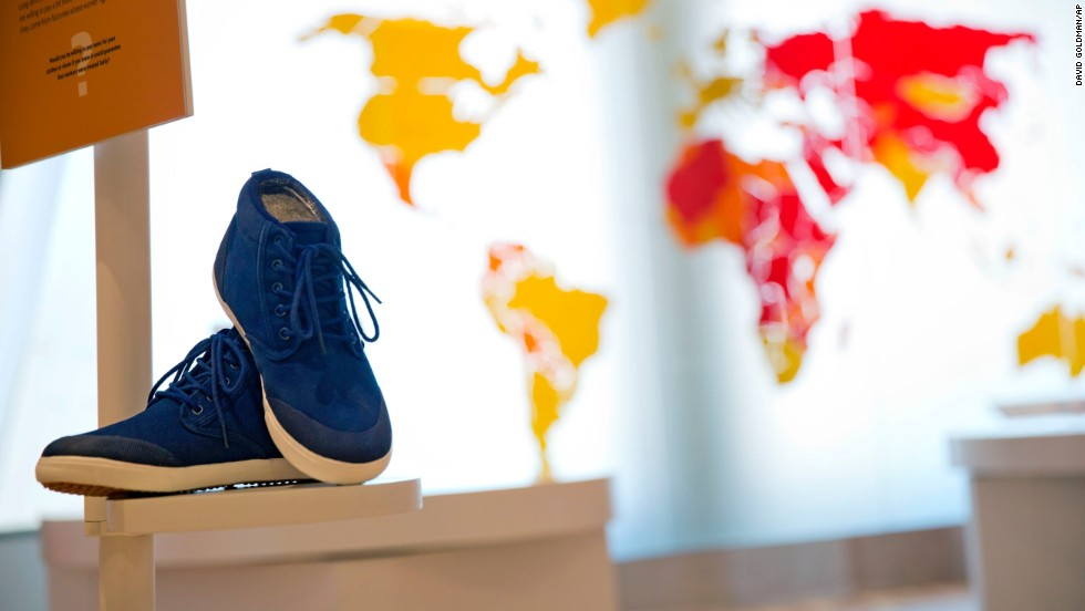 A pair of sneakers are displayed as part of an exhibit exploring the ethical footprint of common consumer products. The museum explores human rights struggles beyond the civil rights movement.