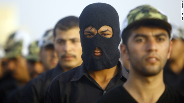 Newly-recruited Iraqi volunteers take part in a training session on June 20 2014, in the southern Shiite Muslim shrine city of Najaf as thousands of Shiite volunteers join Iraqi security forces in the fight against Jihadist militants who have taken over several northern Iraqi cities.