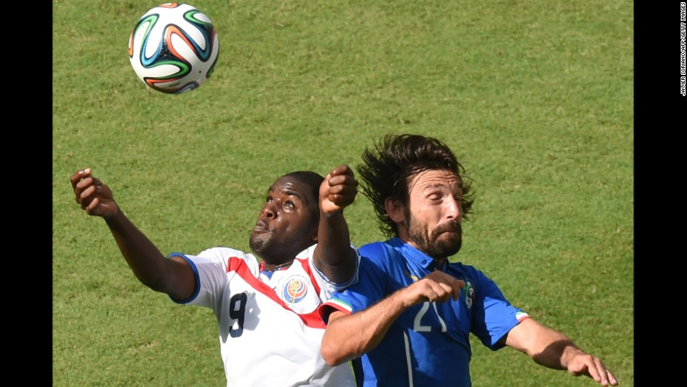 Costa Rica forward Joel Campbell, left, and Italy midfielder Andrea Pirlo vie for the ball.