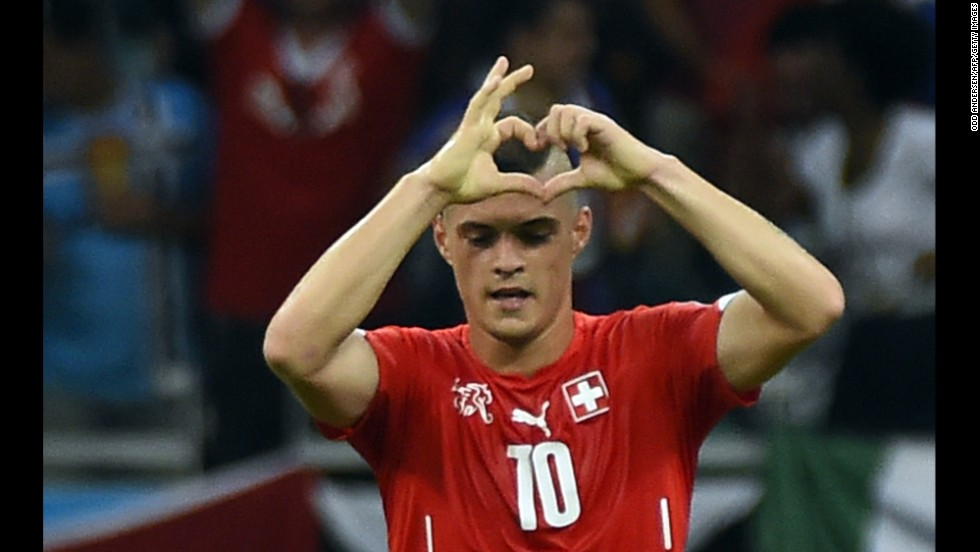 Swiss midfielder Granit Xhaka gestures after scoring his team's second goal late in the second half.